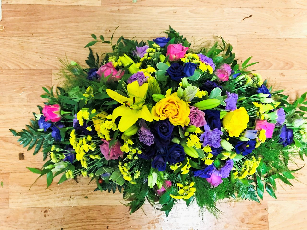 Purple yellow blue funeral spray dooleys flowers purple yellow blue funeral spray izmirmasajfo